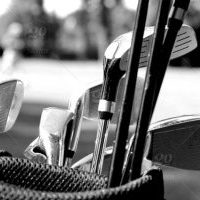 stock-photo-sport-close-up-fun-golf-course-golf-recreation-golfer-golf-clubs-golfing-0047cf2e-3997-4314-9016-e8bacf174792-blackwhite-300x233
